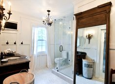 small bathroom remodel made a world of difference...with t.v, wall sconces and 3 chandeliers! loving it! mirror from restoration hardware and laundry basket from kuhl-linscomb