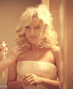 """Kelly wearing a small size version of the """"Full Bloom"""" birdcage veil"""