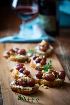 Slow roasted grape crostini with goat cheese and walnuts with a ...