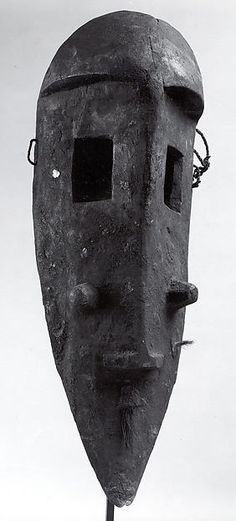 Mask: Monkey (N'Gon Koun) Date: 19th–20th century Geography: Mali, Djitoumou region Culture: Bamana peoples Medium: Wood, mica, fiber Dimensions: H. 21 1/4 x W. 7 1/4 in. (54 x 18.4 cm)
