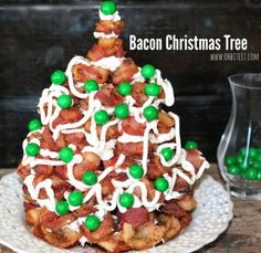 Bacon Christmas Tree - cooking and assembling a bacon tree. Amy of the food blog Oh, Bite It! shows us how to follow the old ways and make the classic decoration/breakfast.  You'll need 3-4 pounds of bacon. Cut the strips in half, then bake them in muffin pans. Pile them into the shape of a tree, using vanilla or maple cake frosting as an adhesive. Add a bit of decorative flair, such as sprinkles or (my suggestion) even more frosting.