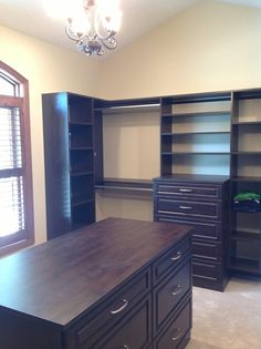 A beautiful island in a master closet with plenty of storage