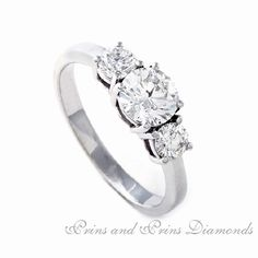 Superb and feminine design ! Centre diamond is a Round brilliant cut diamond with 2 = GH/SI round brilliants set in a straight platinum band Three Stone Diamond Ring, Three Stone Rings, Feminine, Engagement Rings, Band, Centre, Jewelry, Classic, Women's