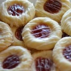 Raspberry and Almond Shortbread Thumbprints - Shortbread thumbprint cookie filled with raspberry jam, and drizzled with glaze,,