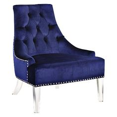 With a curved back and diamond tufting, this traditional accent chair is wrapped in brilliant blue fabric and enhanced with a clear acrylic base.