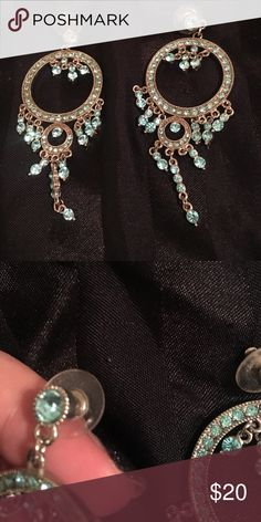 Aqua and silver costume earrings Very sparkly silver and aqua rhinestone chandelier earrings. Somewhat heavy. Worn once. Jewelry Earrings