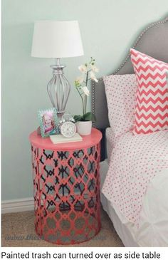 Trash can, painted, turned upside down and used as a night stand. CUTE! CLEVER!! #bedroom