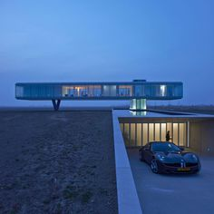 Ecological house in a glass box raised above the landscape by Paul de Ruiter Architects