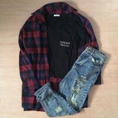 Grunge outfit idea nº7: Dark flannel patterned shirt, ripped blue jeans, black T