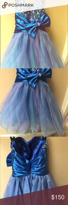 Prom dress Blue beaded with a bow .It has purple, turquoise and blue bottom layers .very beautiful for prom or homecoming.this dress has no sign of wear.it was worn once Let's Fashion Dresses Midi