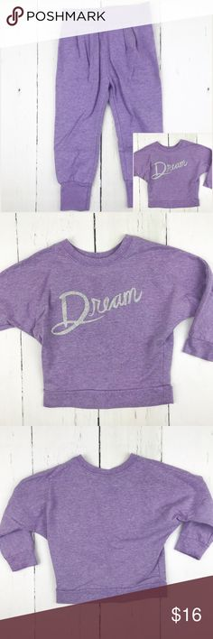 Girls Old Navy Bundle Sweatshirt and Joggers 2T This listing is for the bundle of the Old Navy Dream purple sweatshirt and Old Navy purple joggers.   Sweatshirt: It has soft fleece lining on the inside, and is still lightweight. It has batwing style sleeves and the Dream graphic in silver glitter on the front. 60% cotton, 40% polyester.  Joggers: These super soft light purple joggers have a soft, fleece lining on the inside. They have an elastic waist and ankles, and have pleating on the…