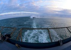 A landing craft air cushion (LCAC) approaches the well deck of the amphibious dock landing ship USS Carter Hall (LSD 50). Carter Hall is deployed as part of the Kearsarge Amphibious Ready Group with embarked Marines from the 26th Marine Expeditionary Unit (26th MEU) supporting maritime security operations and theater security cooperation efforts in the U.S. 5th and 6th Fleet areas of responsibility. (U.S. Navy photo by Mass Communication Specialist 3rd Class Chelsea Mandello/Released)