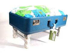 I like this use of an old suitcase as a foot stool or an animal bed.