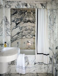 Obviously this marble is not the look we are going for but would you ever want to do center mounter plumbing fixtures like this? Then have him quote a rain shower head just to see if we can work it into the budget?