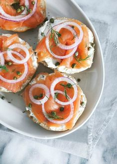 Thinly sliced Salmon, cream cheese and onions on a bagel.