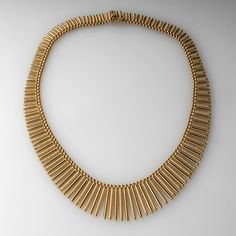 Fancy Articulating Link Necklace Textured Solid 18K Gold This stunning articulating gold necklace is gorgeous and weighs a heavy 68.1 grams of 18k yellow gold. The necklace is made up of both textured and high polished hanging links that are graduated in size.