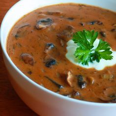 Hungarian Mushroom Soup! Hearty, rich and delicious! Caramelized onions, cremini mushrooms, a heap of paprika and a variety of other ingredients combine to make this a guaranteed hit!