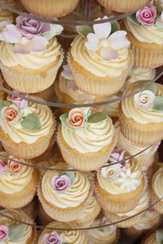 110 cupcakes, each piped with vanilla buttercream and finished with hand made roses and blossoms. Top of 7 tier stand also featured a chocolate mud cutting cake