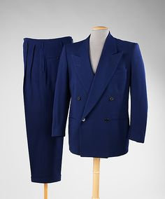 1945 Around this time, men's suits were often double-breasted with peaked lapels. Solid blue was a popular color for suits and jackets were relatively short to conserve fabric. (Kalise W. 1940s Fashion, Mens Fashion, Vintage Fashion, Man Dressing Style, Masculine Style, Mens Suits, Zoot Suits, Suit And Tie, Gentleman Style