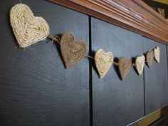 this would be cute to hang on a vintage window.....  string of hearts made by cutting heart   shape and then using a hot glue gun to adhere jute twine.... could use crochet cotton too.