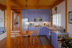 John Cole Architect - color of cupboards in a compact kitchen