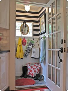 Love the stripes and the ceiling...too bad I most likely will never need a mud room...