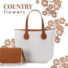 Country flowers: ispirazione country con romantici fiori disegnati nei toni della terra e del cuoio per una tendenza che ci riporta nel far west. #ss16 #country #cowboy #romantic #obag #retro