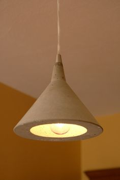 """a concrete """"martini pendant"""" light. I actually gasped when I saw this. $175 I can't wait to buy some of these."""