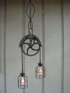 Upcycled Vintage Well Pulley Light - AHH This would be such a great entry way lamp