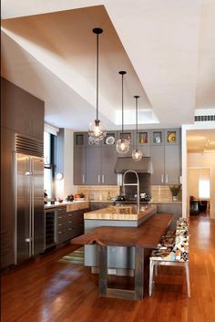 modern-kitchen-design-pendant-light-and-cutting-edge-table - Home Decorating Trends - Homedit #homedecor