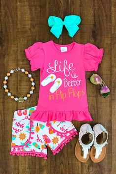 """Our darling summerpom pom short set isso cute! Soft pom pom shorts and a matching short sleeve top with """"Life is Better in Flip Flops"""" written on the front. S"""