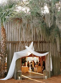 The entrance to the creekside reception. (Photo Credit: Marni Rothschild) #SouthernWeddings #charleston