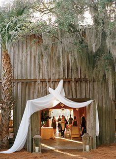 The entrance to the creekside reception. (Photo Credit: Marni Rothschild) #SouthernWeddings #charleston