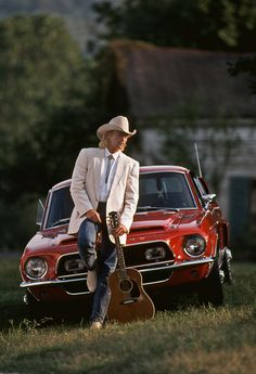 alan jackson  Two birds with one picture; a fav country singer, and my fav car!