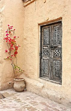 Saidpur Village - rustic pot with skinny bougainville. The window is gorgeous also#Repin By:Pinterest++ for iPad#