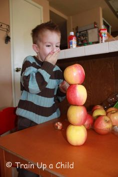 """A is for APPLES  Stacking apples and printing with apples - activity extensions for """"Ten Apples Up On Top"""" by Dr Seuss."""