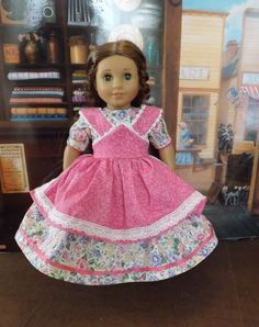 Beautiful gown by newyorkdolldesigns on ebay--I challenge you to repin this! 1850's style Apron Dress for American Girl Marie Grace, Addy, Kirsten, Cecile #historicaldollclothes