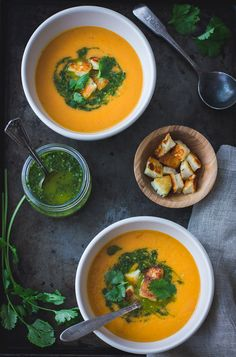 ROASTED YELLOW TOMATO SOUP WITH GREEN HARISSA & HALLOUMI CROUTONS.  Visit The Bojon Gourmet.