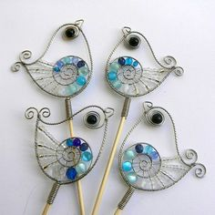 Wired Birds of stainless steel wire, plastic and glass beads