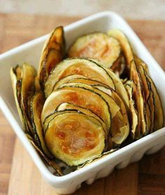 Zucchini Oven Chips  1/4 cup ground almonds 1/4 cup grated fresh Parmesan cheese 1/4 t seasoned salt 1/4 t garlic powder 1/8 t black pepper 2 T fat-free milk 2 1/2 cups (1/4 inch-thick) slices zucchini Cooking spray  Preheat oven to 425. Combine first 5 ingredients in medium bowl, stirring w/whisk.Pour milk in shallow bowl.Dip slices in milk.Dredge in dry mixture.Place coated slices on wire rack coated w/cooking spray; place rack on baking sheet.Bake @425 for 30 minutes or until brown…