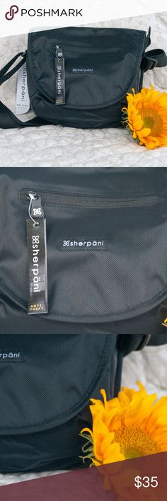 """Sherpani Black Milli Crossbody Bag with RFID Sherpani  Black Milli RFID Protected Crossbody bag is perfect for you next trip or casual outing. It's perfect for carrying your 7"""" tablet but will fit a 9"""" tablet. The interior lining is a light blue color and it has pockets for all of your essentials.  10"""" x 9.5"""" x 3.5"""" - Weight: 8 oz  Main zipper compartment, magnetic flap closure, an exterior zip pocket Under flap zipper pocket, an interior zipper pocket, two interior slip pockets 9"""" Tablet…"""