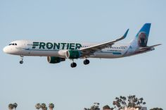 """Frontier's """"Seymour the Walrus""""A321 arriving from DEN on May 1, 2017."""