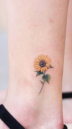 Celebrate the beauty of nature with this Inspiring Sunflower Tattoos Their distinctive and brilliant looks and with their rich symbolism, it's easy to see why sunflower tattoos are a popular topic among tattoo Sunflower Tattoo Simple, Sunflower Tattoo Shoulder, Sunflower Tattoos, Sunflower Tattoo Design, Watercolor Sunflower Tattoo, Watercolor Tattoos, Abstract Watercolor, Dainty Tattoos, Symbolic Tattoos