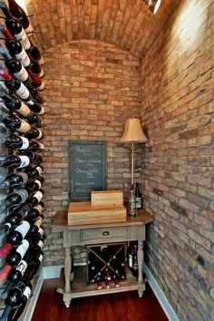 This wine cellar boasts beautiful brick walls and ceilings and plenty of racks for storing wine.