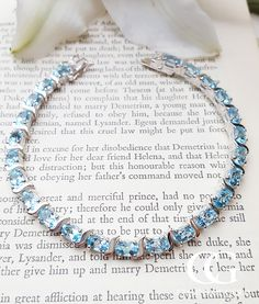 "A gorgeous Sterling Silver & Blue Topaz Tennis Bracelet 7.5"" sold by Assay Assured Retailer. Secure next day delivery via Royal Mail."