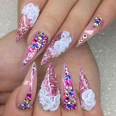 Stiletto Nails With pink Glitter, Rhinestones, and Hand Painted Flowers.