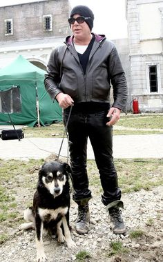 """Mickey Rourke- great actor with a soft spot for dogs. Here he is pictured with """"Foxy"""", a Romanian stray, whom he rescued while filming. After learning of the """"stray problem"""" in Romania Mickey committed to forming """"Wild Dogs of Romania Sanctuary"""". Shelter Dogs, Animal Shelter, Rescue Dogs, Animal Rescue, Mickey Rourke, Taylor Swift Cat, Celebrity Dogs, Street Dogs, Vintage Mickey"""