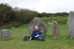 Drombeg Stone Circle in County Cork. Terence Meaden completing a new survey.