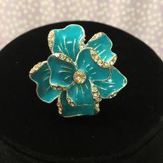 Stunning Turquoise Flower Ring! Beautiful turquoise color ring. Eye catching elegance and great for all occasions. Size unknown.  Bundle items and save with my discount! Jewelry Rings