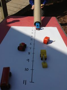 Understand place value in EYFS. But, for preschool, simply measuring the distance traveled. closest to the tube, furthest, etc.